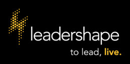 LeaderShape logo with yellow lightning bolt and slogan