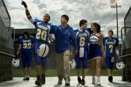 FRIDAY NIGHT LIGHTS -- Pictured: (l-r) Taylor Kitsch as Tim Riggins, Gaius Charles as Brian