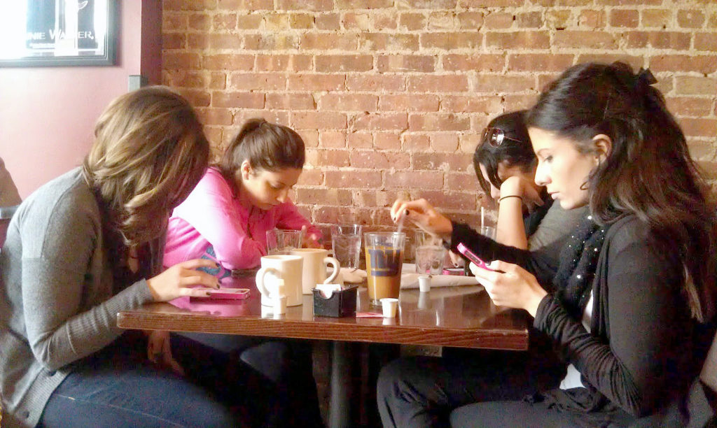 Using your phone while out with friends can potentially put your social media safety at risk