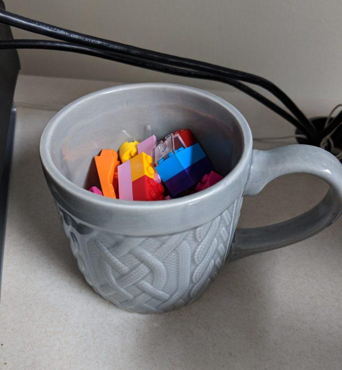 Gray mug of Lego that I keep on my desk at work