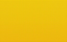 A yellow background of Lego brick